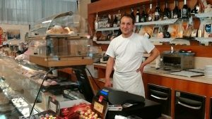 Gennaro Immobile behind the counter of his pasticceria